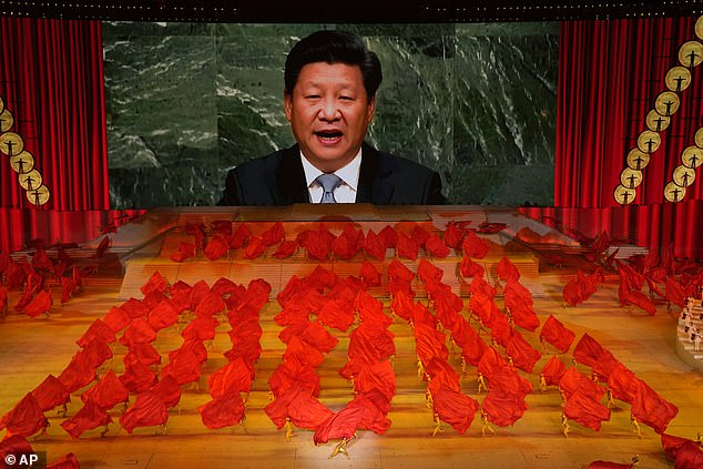 Sir Iain revealed that intelligence chiefs have warned he is under 'active and direct threat' from the Chinese state. Pictured, president Xi Jinping speaks via video at an event last month