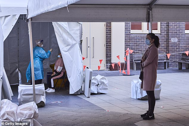 New modelling from Melbourne University led by epidemiologist Professor Tony Blakely suggests it's likely to take at least five more weeks for Sydney's daily case number to drop (pictured, a testing centre in Sydney on Tuesday)