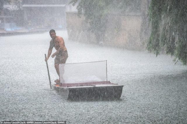 Thunderstorms and floods look set to hit the UK as the nation basks in sweltering temperatures - with a yellow warning in place for the Eat Midlands, South East and East of England for Tuesday. Pictured: Cambridge