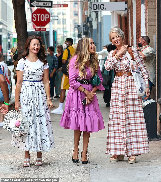 Happily reunited! Sarah Jessica Parker (M), Kristin Davis (L), and Cynthia Nixon (R) were all smiles while filming a street scene for HBO Max's And Just Like That in Manhattan's SoHo neighborhood on Tuesday