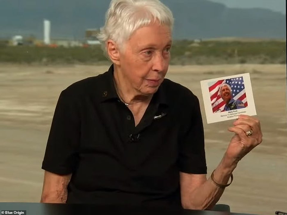 The post card shows her in front of the American flag on board the space launch