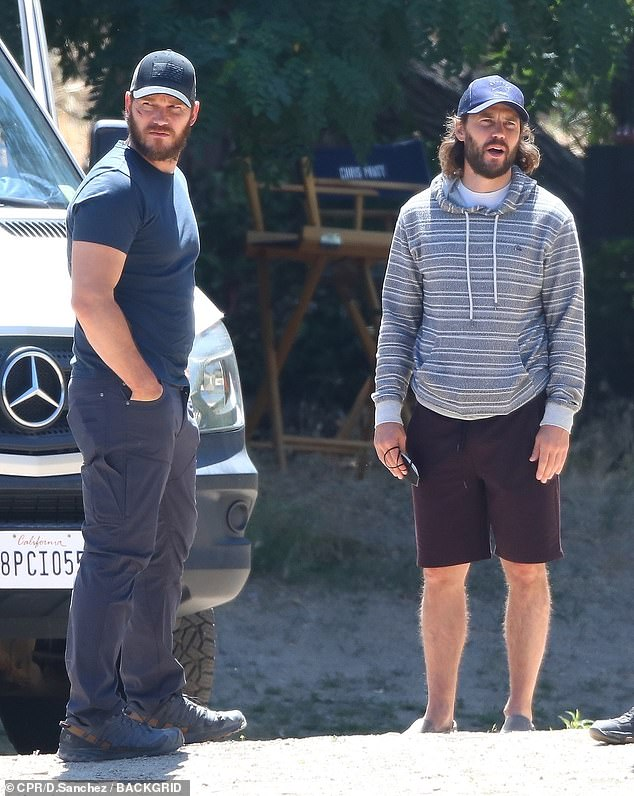 Hard at work: Chris Pratt and Taylor Kitsch were seen idling on set while waiting to film a boat scene for their upcoming conspiracy-thriller series The Terminal List