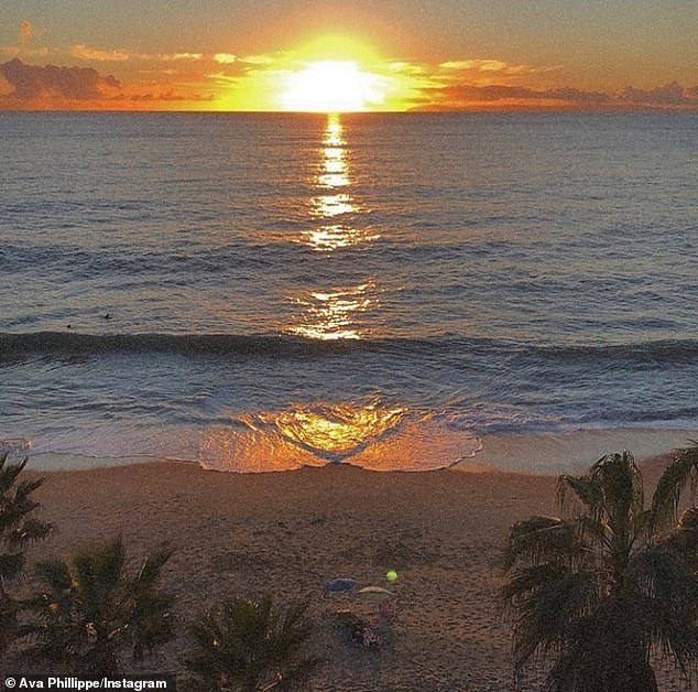 It's paradise: The blonde beauty also shared a view of the ocean and sunset