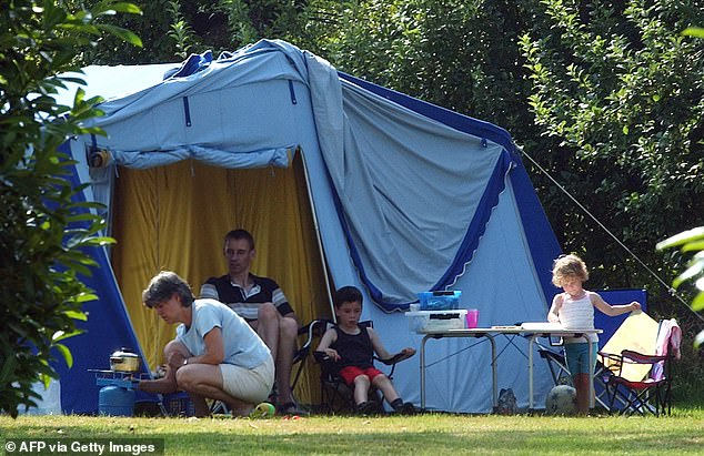 Holidaymakers seen taking a rest near their tent at a campsite in western France (file photo)