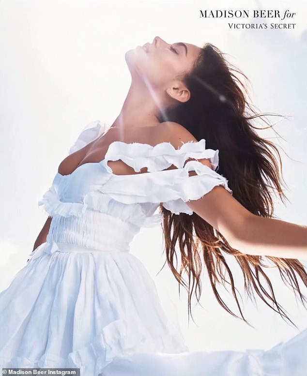 Covered:Ringing in a new era for VS, Madison slipped into a flowy white dress - not skimpy underwear - to frolic around a field in the promo for the company's new Scent Tease Crème Cloud fragrance