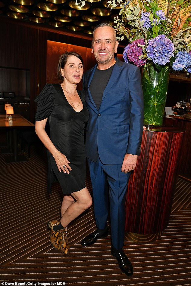 Strike a pose: Sadie posed up with Fat Tony and showed off her snakeskin effect boot