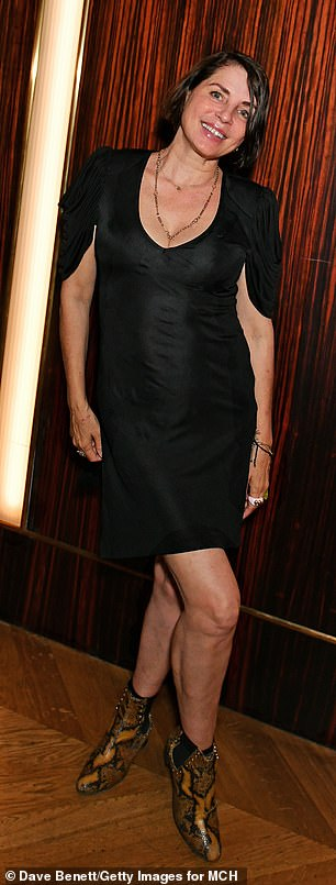 Radiant:Sadie looked chic in a black dress worn with snakeskin effect boots as she posed up a storm