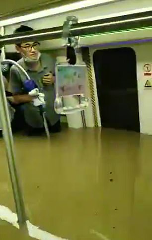 Some passengers stood on seats to try and escape the rising waters