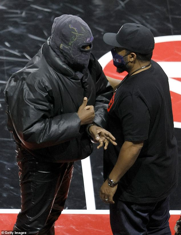 New look:Kanye has also recently been seen in a similar full-face mask last week when he stopped to chat with legendary rapper Ice Cube during a game for his Big3 three-on-three basketball league; seen on July 17