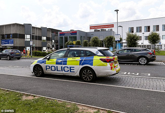 A police car parked outside New Cross Hospital, Wolverhampton, after the stabbing yesterday