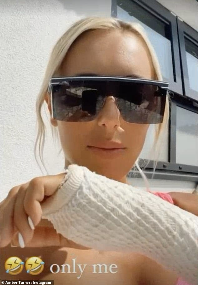 Water baby:The blonde bombshell also made the most of the UK heatwave by slipping into a pink Fendi swimsuit and jumping into her hot tub as se shared a clip detailing her injury