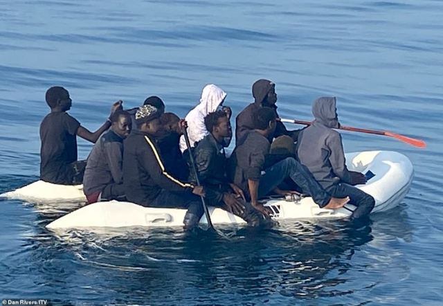 Migrants from mostly Sudan were pictured paddling across the Channel 10 miles off the coast of France, ITV reported