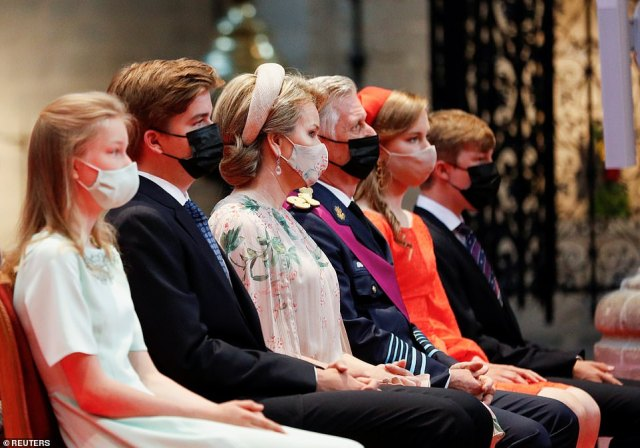 Queen Mathilde and King Philippe were flanked by their children as they took their seats in the cathedral in Brussels today
