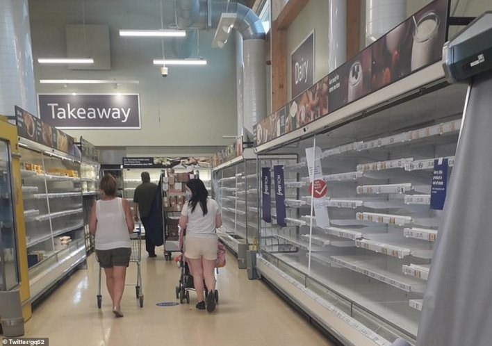 Shoppers have shared photos of gaps on the shelves at some supermarkets as the food supply chain was hit by a surge in self-isolating workers