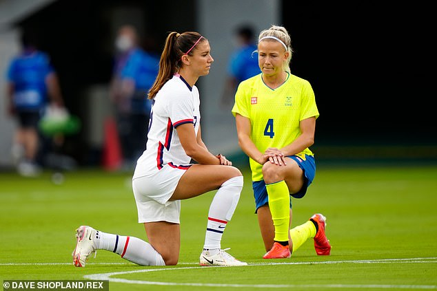 Alex Morgan from the US and Hanna Glas from Sweden join the gesture at the start of their clash in Tokyo