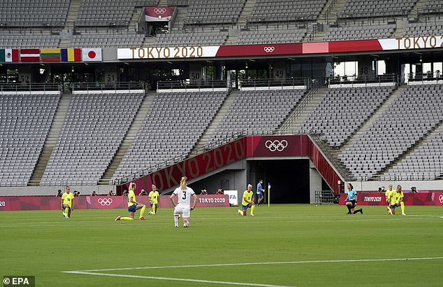 All 22 players participated in the gesture ahead of the kick-off between four-time Olympic champions USA and Sweden in Tokyo