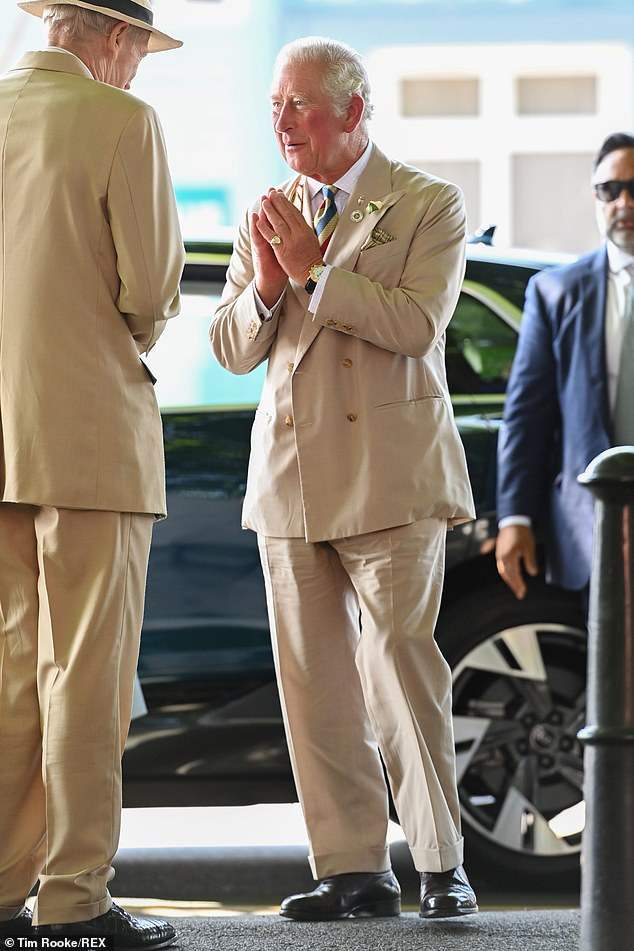 The Prince of Wales, who was dressed for summer in a beige suit, greeted staff at the exhibition with a namaste gesture