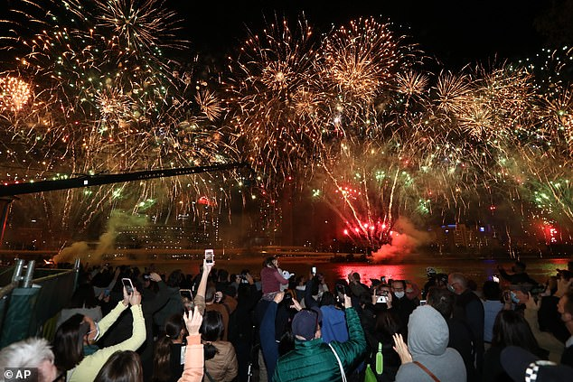 Fireworks erupt in the sky in Queensland (pictured on Wednesday night) as Brisbane residents celebrate the Olympic Games coming to their city in 2032