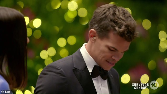 Fake? Bachelor Nicholson was pictured wearing an earpiece in his right ear during his first red carpet meeting with his suitors on Wednesday night