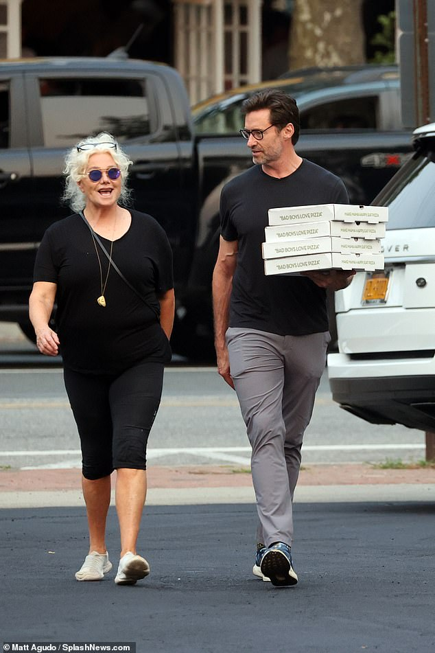 Pizza party! Hugh Jackman,52, and his wife Deborra-Lee Furness,65, picked up takeaway pizza in The Hamptons on Tuesday
