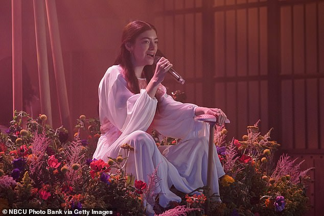 Outfit change: She had a change of outfits for the performance, wearing a pink and white smock dress and sitting on a bed of flowers