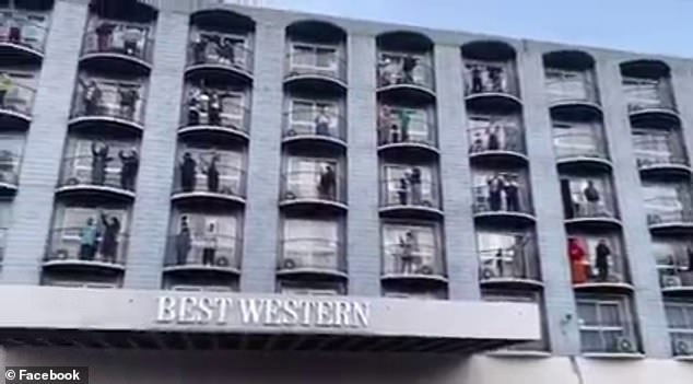 Samoan workers flooded the balconies of their Hobart quarantine hotel to sing a song of thanks to their hosts (pictured)