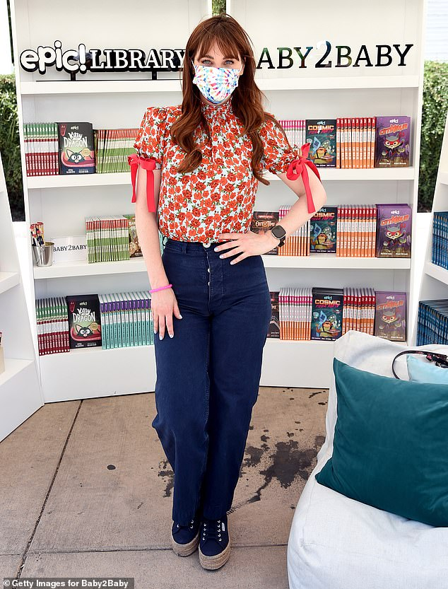 Casual: The actress opted for a floral-print blouse with short sleeves and ribbons.  She wore it in blue jeans and added a pair of wedge shoes