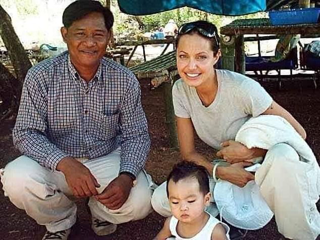 Sarath Mounh ran an NGO in Cambodia and was friends with Angelina Jolie in 2002 around the time she adopted her eldest son Maddox.  Pictured: Mr Mounh with Jolie and Maddox