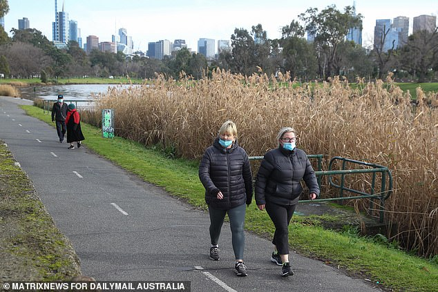 Melbourne will be closed until at least July 27.  Pictured: Residents at Yarra River on Thursday