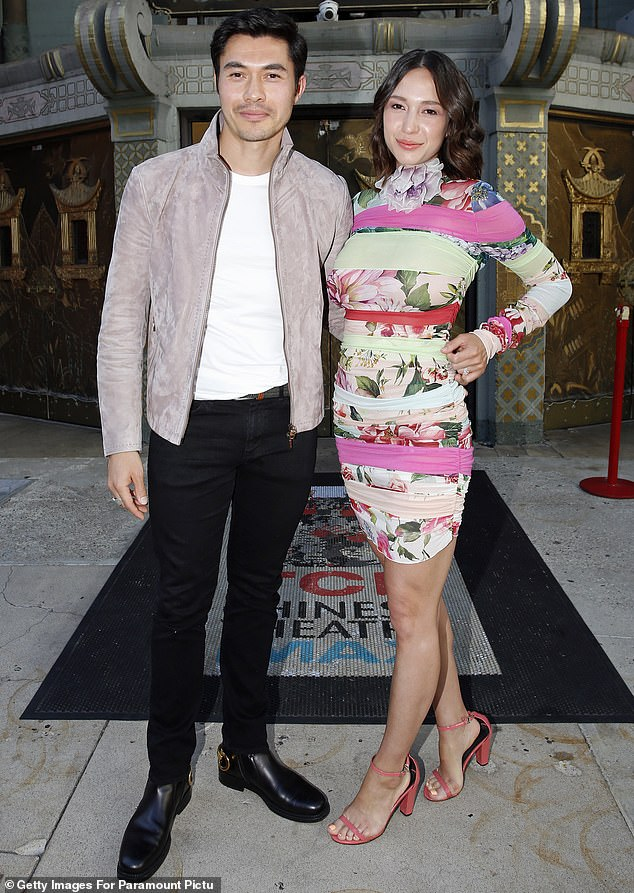 Swank: Henry Golding posed with wife Liv Lo during a pre-screening of his upcoming movie Snake-Eyes: GI Joe Origins at the TCL Chinese Theater in Hollywood