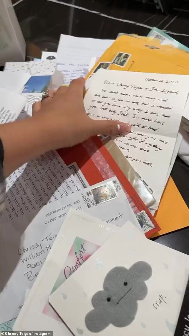 Unearthed: The model ran her hand over a stack of handwritten letters that she and her husband John Legend finally had access to after the recent reopening of the WME office