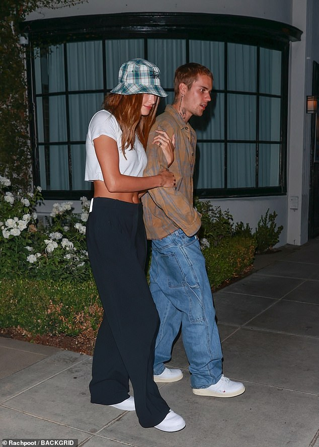 Tonic: Hailey Bieber showed off her toned abs in a white cropped top as she left a West Hollywood sushi restaurant with husband Justin on Wednesday night
