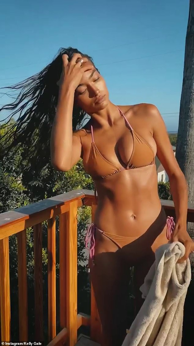 Star: The Australian model looked toned and tanned as she emerged from a backyard pool in a nude bikini, drying herself before donning skimpy sportswear