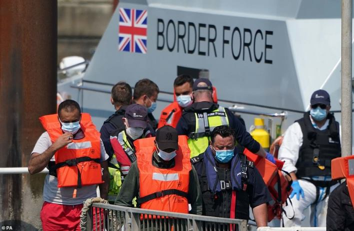 A group of people thought to be migrants are brought onboard a border force boat following an incident in the Channel