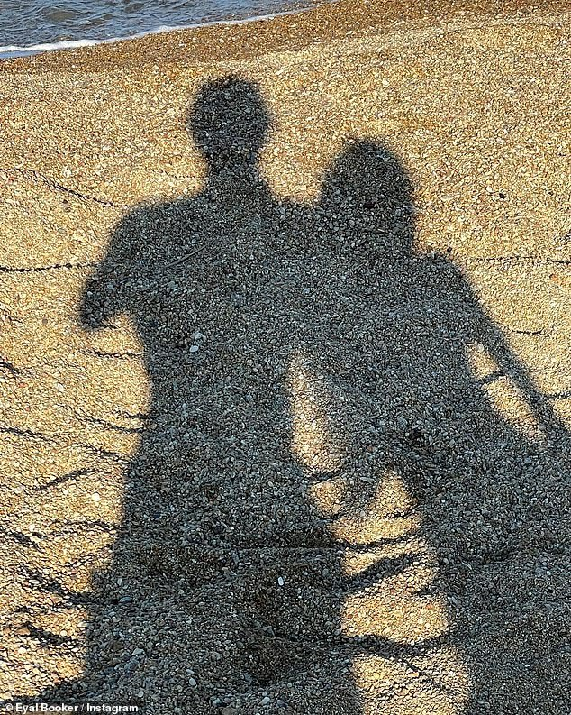 Artistic: And a final image, included in the recently uploaded collection, showed the collective shadows of Eyal and Delilah blasted down onto a pebble beach