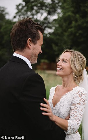 The bride wore a beautiful lace and chiffon dress from the French Notting Hill boutique, The Mews Bridal, with a veil embroidered with a Bible verse