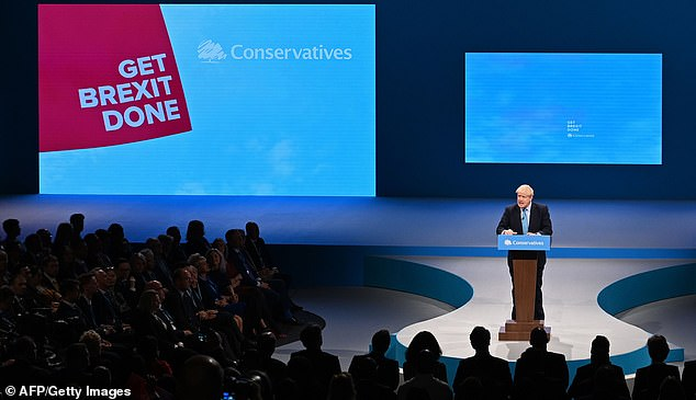 Covid passports will be required a Conservative Party conference despite rebel MPs threatening to boycott the event. Pictured, Boris Johnson addressing the last in-person conference in Manchester in 2019