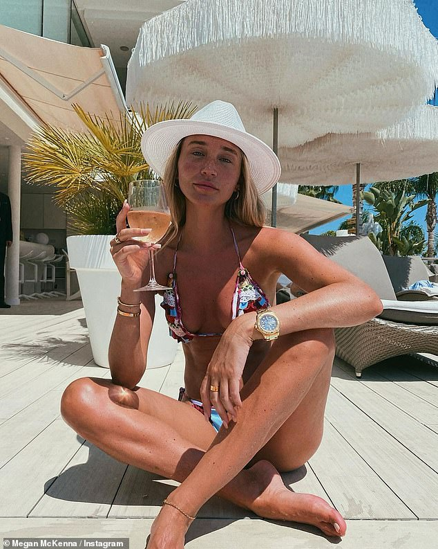'Insta cute is boring': Megan McKenna shows off her enviable physique in a skimpy multicolored bikini in a series of new photos uploaded to her Instagram on Wednesday
