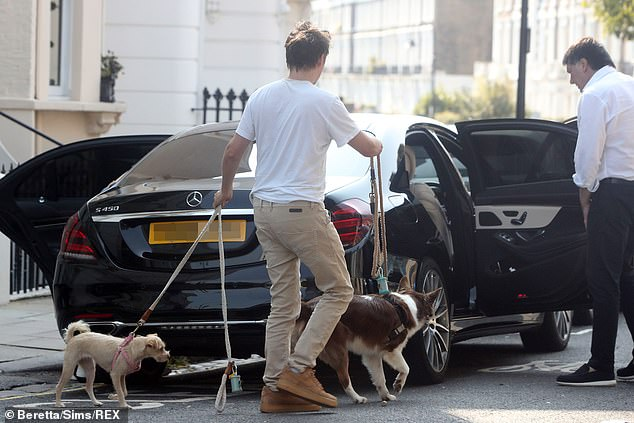 Dog Walk: Matt had his hands full with their two dogs as he watched Elle get into the back of the car