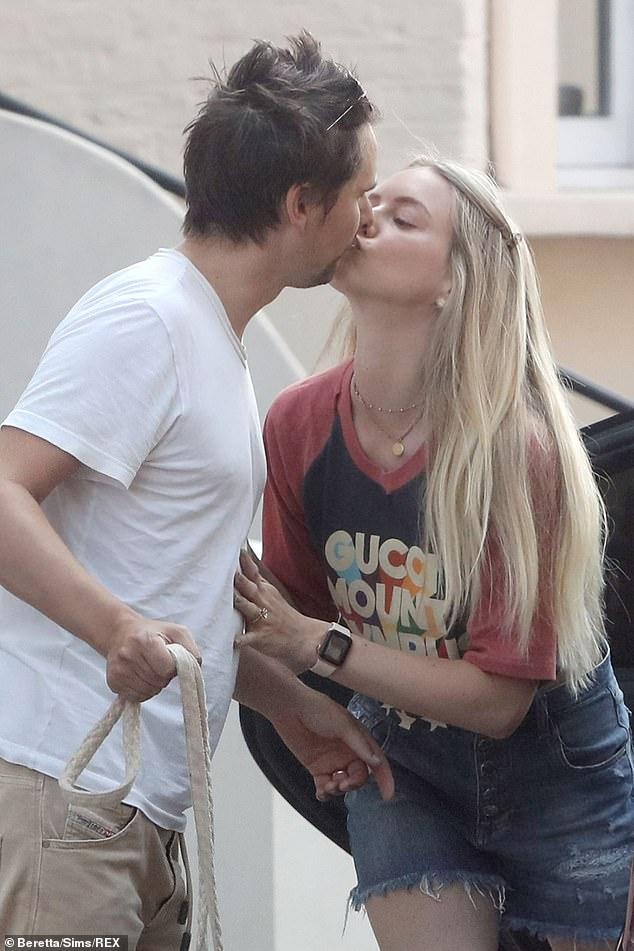 Farewell: Matt Bellamy kissed his wife Elle Evans goodbye in Primrose Hill on Wednesday