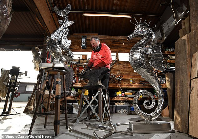 Highly skilled: Michael, who began sculpting aged 21 and uses recycled metals to create fantastic steel artworks of animals, has revealed he was stunned when Gordon paid him £40,000 for the non-commissioned piece