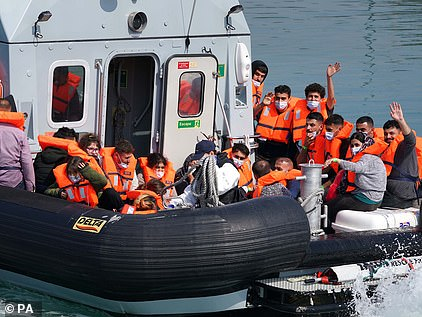 A group of people thought to be migrants are brought in to Dover, Kent, onboard a border force boat following a small boat incident in the Channel