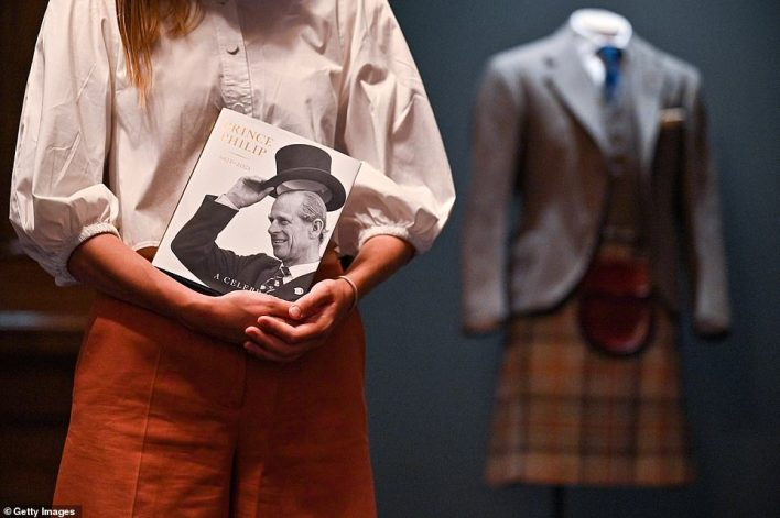 A member of staff holds a comparative book during HRH The Prince Philip, Duke of Edinburgh Commemoration at Holyroodhouse