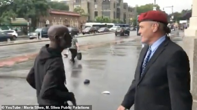 Sliwa repeatedly tells the excited man to 'relax' and warns him that he has dropped his things