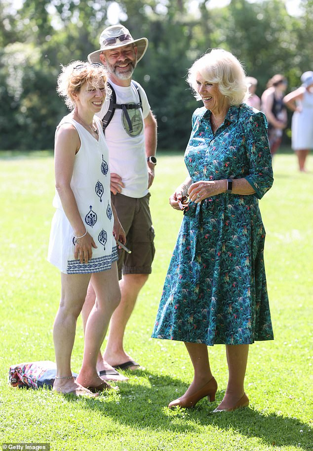 On the second day, visiting a primary school at St Mary's in the Isles of Scilly in Cornwall, the Duchess was the epitome of elegance in a vibrant blue sundress with an exotic bird print (pictured)