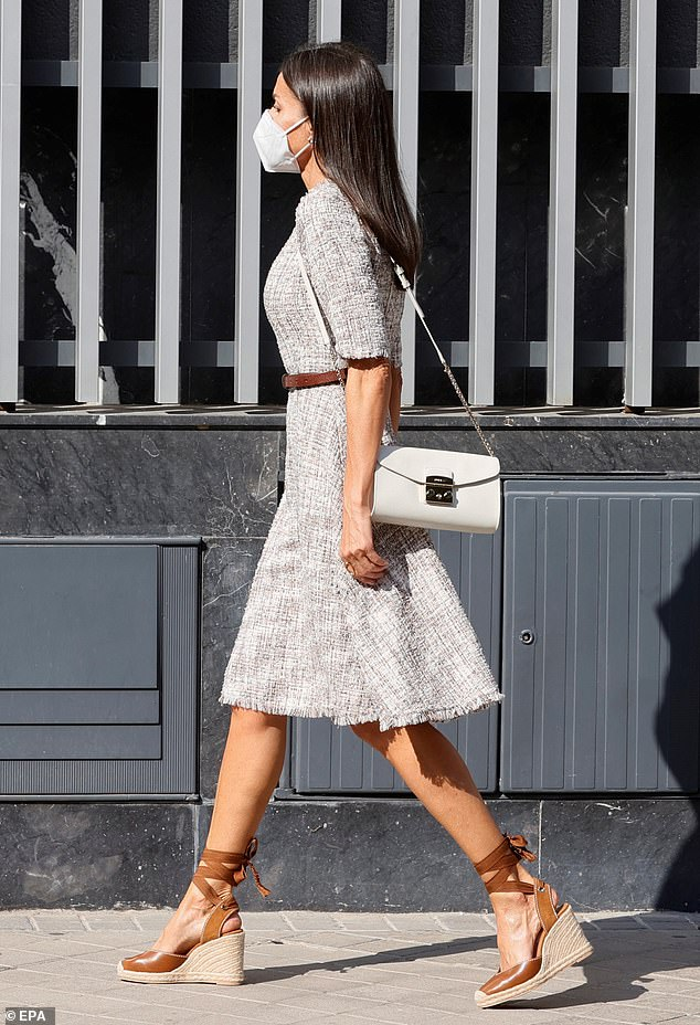 Queen Letizia of Spain, 48, looked summer chic in a pair of brown wedges tied with brown ribbon in Madrid today as she met members of the Spanish Cancer Society