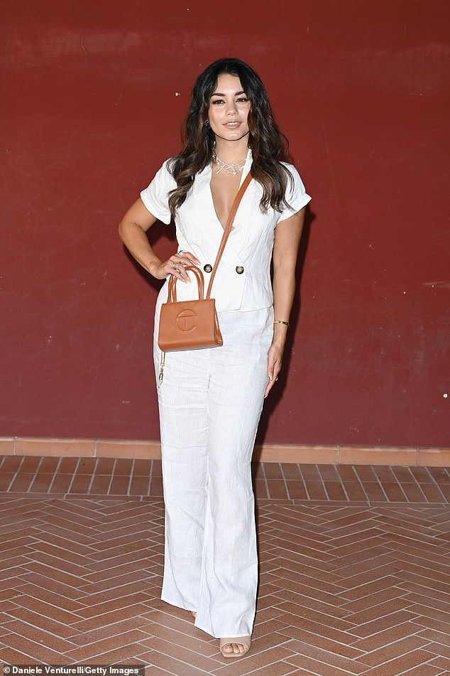 The actress, 32, looked stunning in an opaque white linen suit