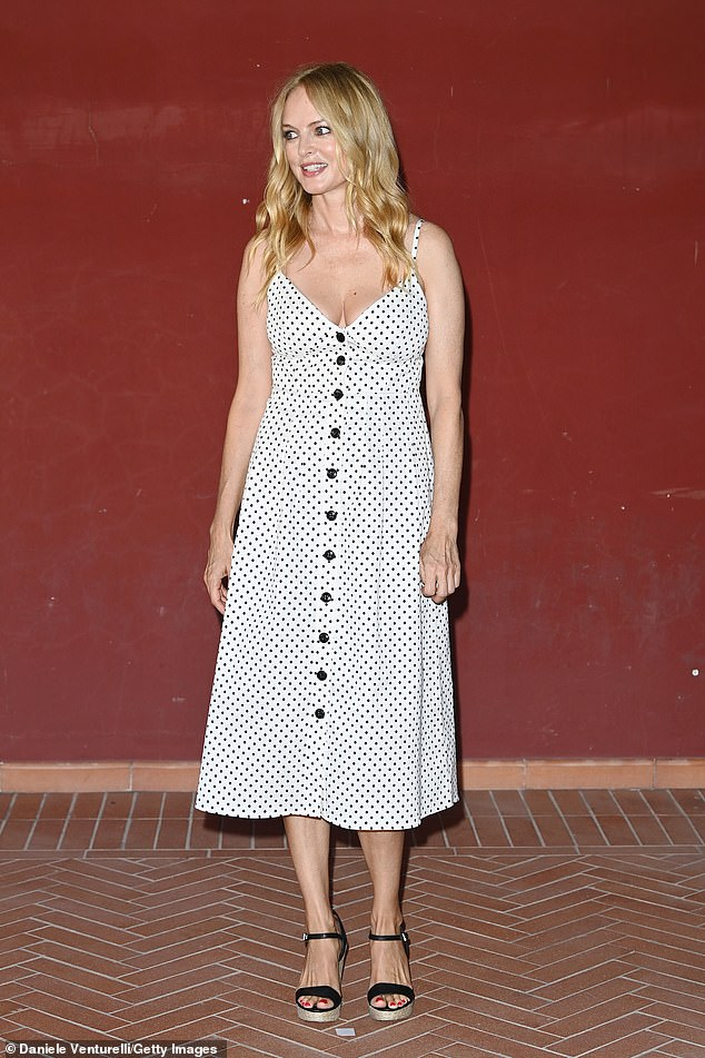 Busty: Heather teased glimpses of plunging neckline in the midi dress that hung over her slender frame