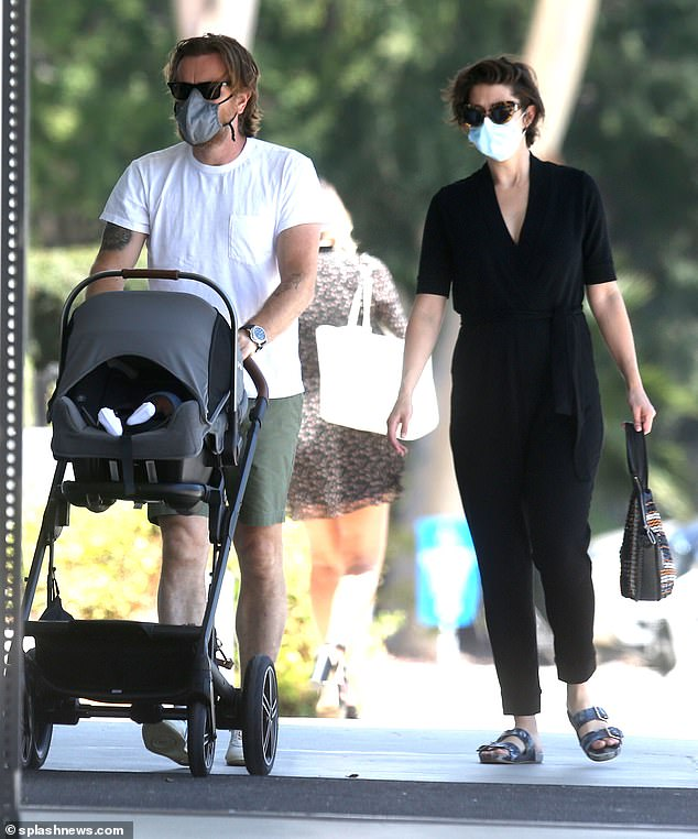 Family: Ewan McGregor was seen for the first time with baby son Laurie as he and girlfriend Mary Elizabeth Winstead took their tot for a stroll in Los Angeles last month