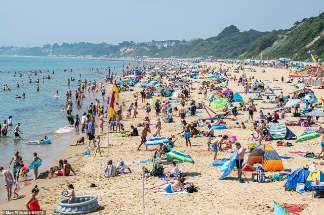 People enjoying the summer weather on the beach at Bournemouth in Dorset today